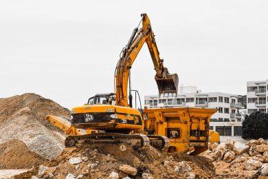 construction-site-heavy-machines-working-yellow